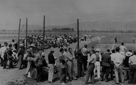 Italian American internees watching a soccer game at Missoula. In the center, with hat and dark sweater, is S. F. actor Guido Trento.